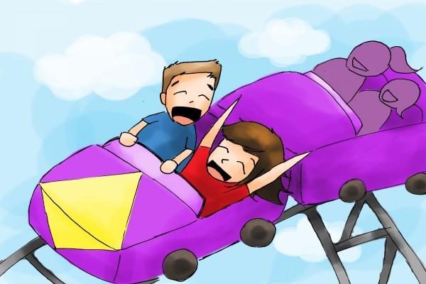 Niños felices en una montaña rusa