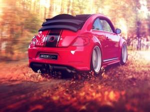 Postal: Un bonito Volkswagen rojo circulando en una carretera con hojas otoñales
