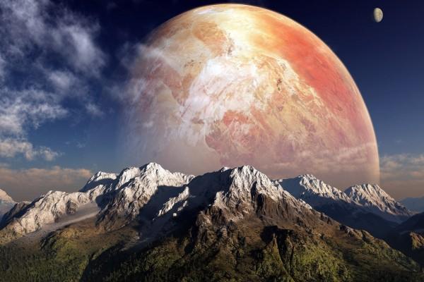 Gran planeta tras las montañas