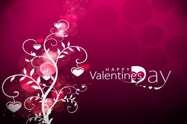 """""""Feliz Día de San Valentín"""" junto a un árbol con corazones"""