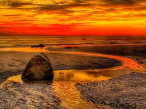 Los colores del atardecer en una playa