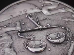 Postal: Horóscopo de Libra en una moneda