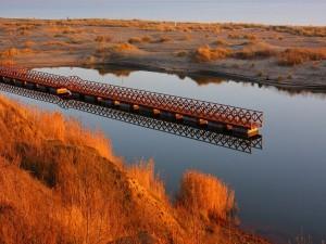 Postal: Muelle sobre aguas tranquilas
