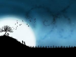 Postal: Pareja de enamorados en una noche de luna llena