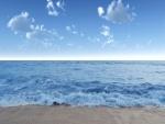 Agua de mar sobre la arena de la playa