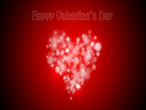 Postal: Feliz Día de San Valentín sobre un corazón brillante