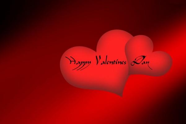 Feliz Día de San Valentín en dos corazones rojos