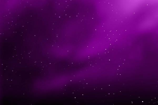 Puntos luminosos en un fondo púrpura