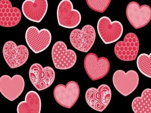 Postal: Corazones rosados en fondo negro