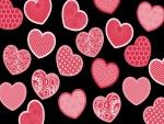 Corazones rosados en fondo negro