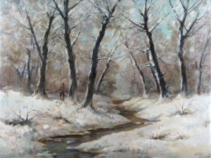 Cazador en un bosque cubierto de nieve