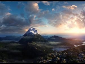 Postal: Sol iluminando la cima de una montaña