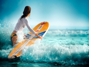 Postal: Surfista con su tabla buscando olas