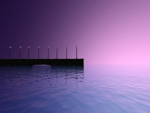 Farolas iluminadas junto a un lago