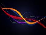 Líneas de varios colores flotando en un fondo negro