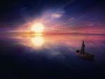 Mujer sobre una barca contemplando el horizonte