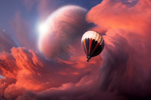 Globo viajando junto a las nubes