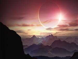 Postal: Eclipse solar sobre unas montañas