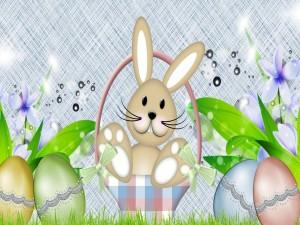 Conejito en una cesta junto a unos huevos de Pascua