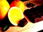 Tableta de chocolate y naranjas