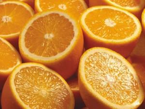 Postal: Exquisitas naranjas cortadas