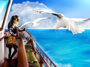 Chica en un barco dando de comer a las gaviotas
