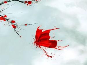 Mariposa de pintura volando cerca de una rama con flores rojas