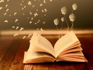 Pájaros, flores y mariposas saliendo de las páginas de un libro