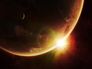 Sol en el espacio iluminando a la Tierra