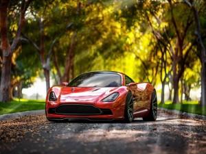Aston Martin DBC Concept a la sombra de una arboleda