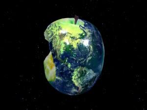 El planeta Tierra con forma de una manzana verde mordida