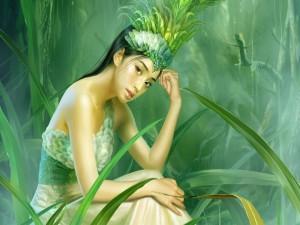 Mujer oriental con hermosos ojos y plumas en el pelo