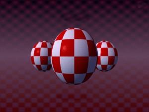 Esferas con cuadros rojos y blancos