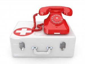 Teléfono rojo sobre un botiquín