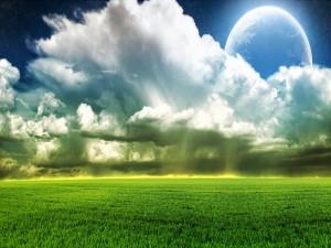 Planeta sobre un prado verde