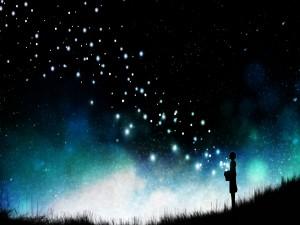 Mujer esparciendo estrellas en el cielo