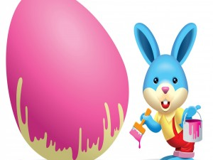 Conejo pintando un huevo de Pascua