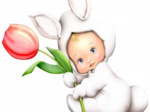 Bebé vestido de conejo con un tulipán