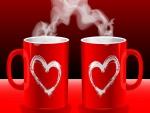 Humeantes tazas rojas con corazones