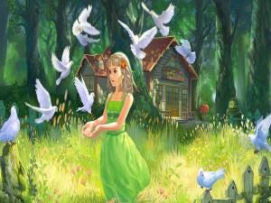 Chica dando de comer a las palomas blancas