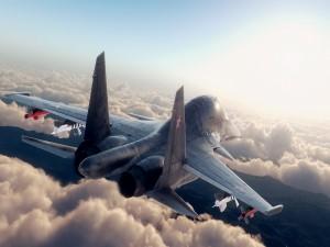 Avión de combate volando sobre las nubes