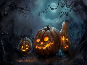 Tres calabazas iluminadas en la noche de Halloween