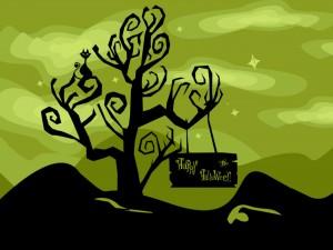 """Cartel de """"Feliz Halloween"""" colgando de un árbol"""