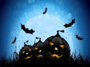 Murciélagos y calabazas en la noche de Halloween