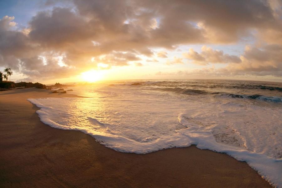 Sol iluminando la playa