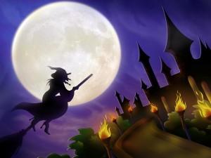 Bruja en una escoba en la noche de Halloween