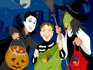 Los niños recogen dulces en la noche mágica de Halloween