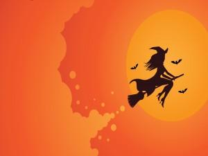 Bruja volando en la noche de Halloween