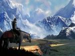 Jinete sobre un caballo mirando las montañas
