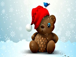 Oso de peluche con un gorro de Navidad sentado sobre la nieve